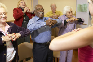 Group Of Senior adults in a stretching class